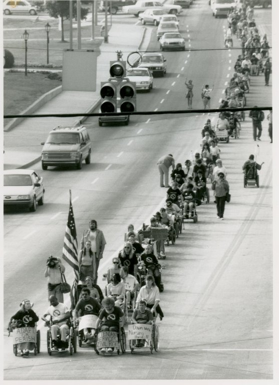 ADAPT disability activists march for rights in Atlanta, 1990