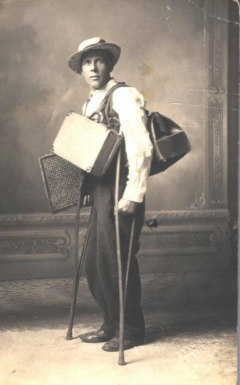 man on crutches with luggage in pose sepia photograph disability history america