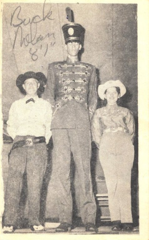 buck nolan next to tall man and woman black white photograph disability history america