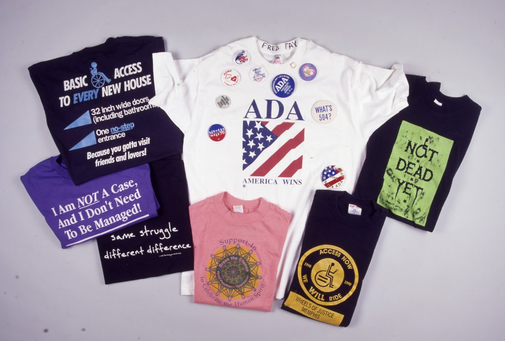 collection of t shirts disability history america