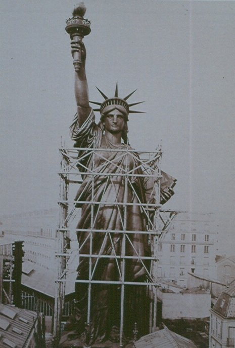 black white photograph statue liberty under construction disability history america