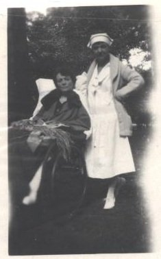 female nurse and patient black white photograph disability history america