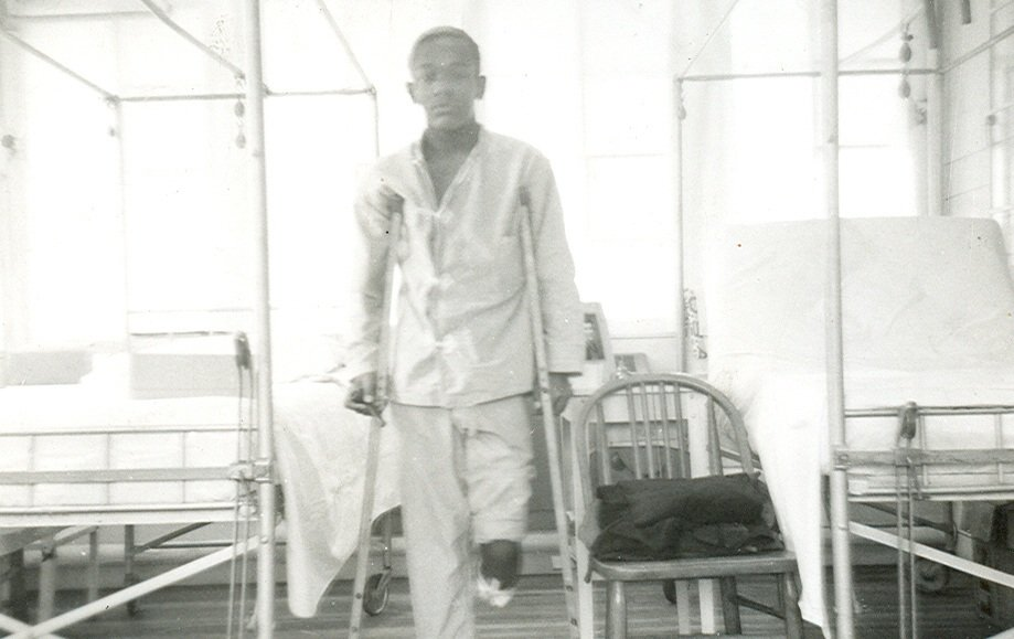 young amputee man in hospital black white photograph disability history america