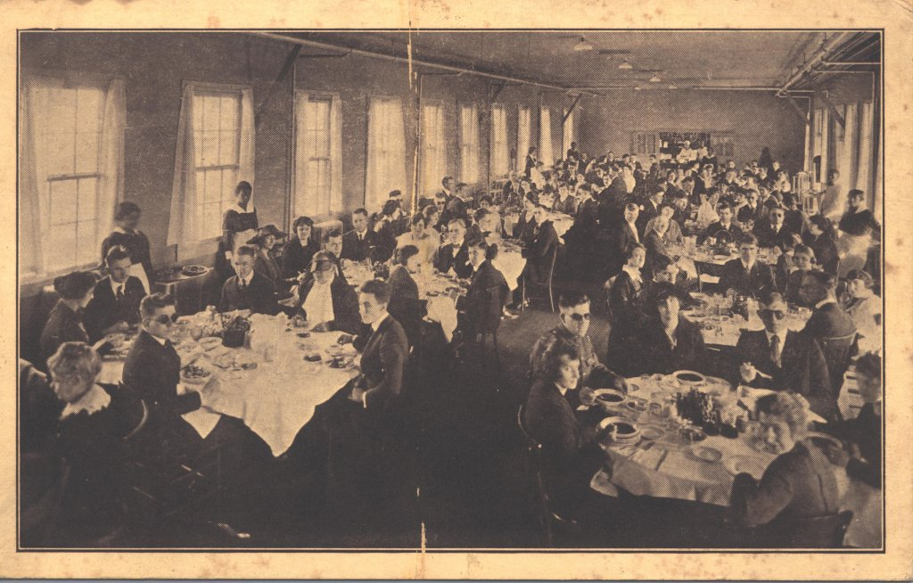 adult men women dining room black white photograph disability history america