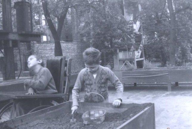 boy playing black white photograph disability history america