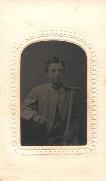 young boy in portrait disability history america