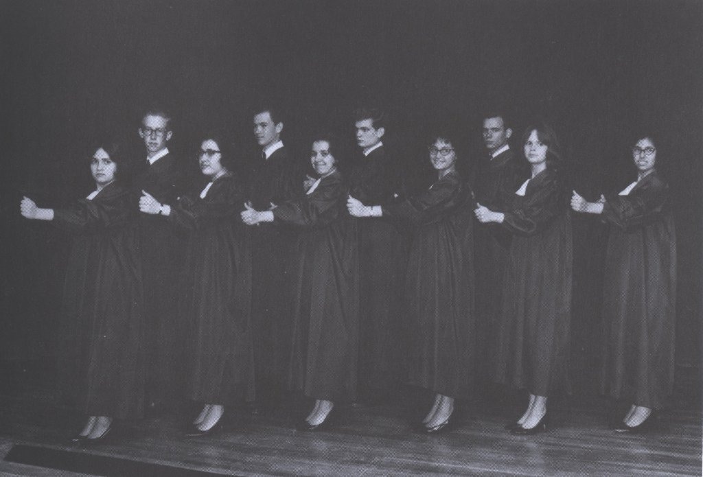 young men and women in file on stage black white photograph disability history america