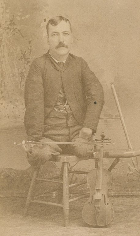 adult male violinist seated sepia photograph disability history america