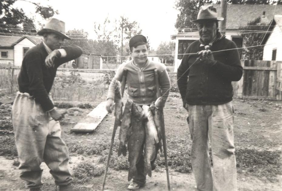 adult and young fisherman black white photograph disability history america