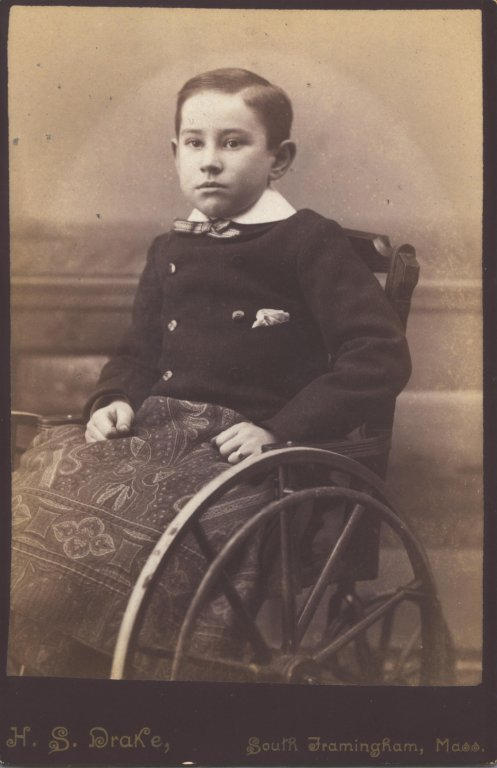 boy in wheelchair sepia photograph disability history america