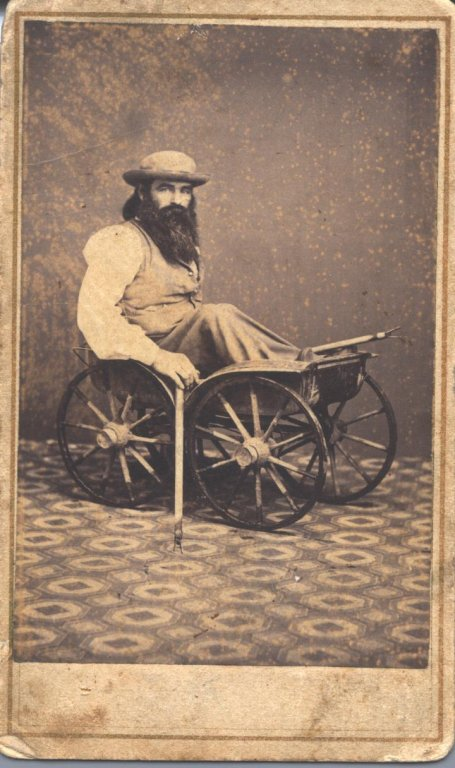 man cart sepia photograph disability history america