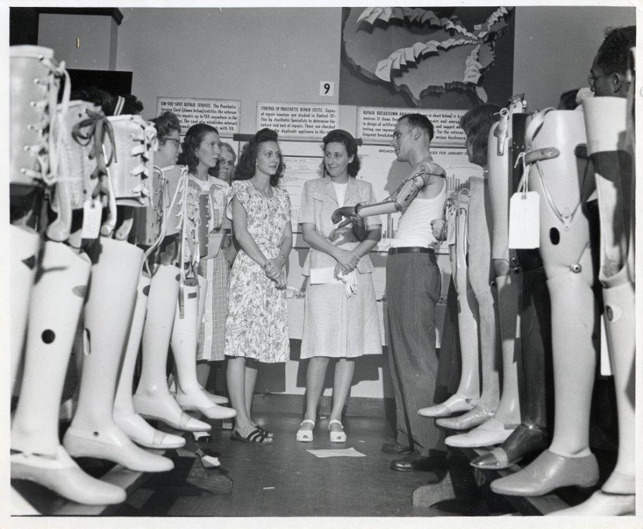 men women prosthetic limbs black white photograph disability history america