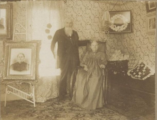 man and woman seated in living room sepia photograph disability history america