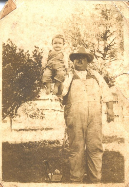 Photo of a man and a young child