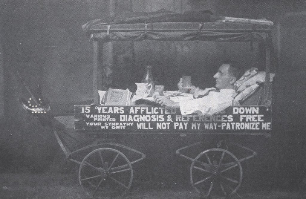 man eating drinking in reclined cart black white photograph disability history america