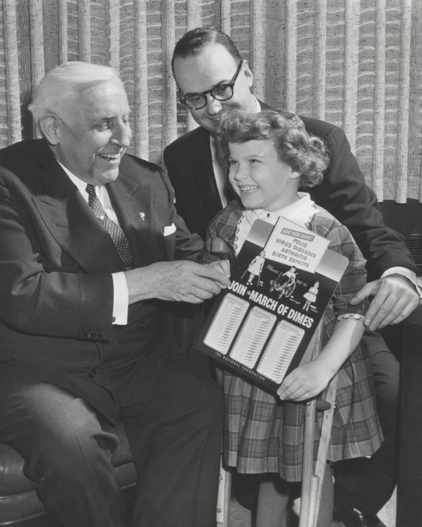 men and child smile in black white photograph disability history america