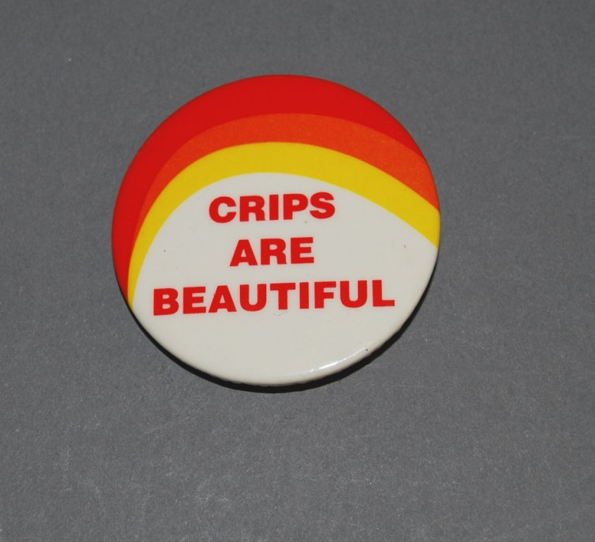 """A white, orange, and yellow button with the words """"Crips are Beautiful"""","""