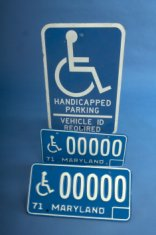 Handicapped parking sign and license plates