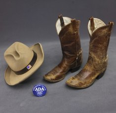 cowboy boots and hat a d a button disability history america