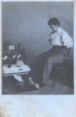 woman typing with feet black white photograph disability history america