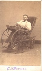 c.h. barnes sitting in custome wheelchair disability history america