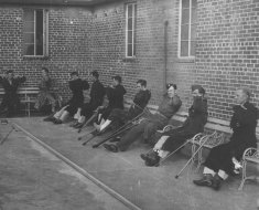 male soldiers exercise seated black white photograph disability america