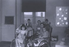male female school children black white photograph disability america