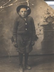 boy in gloves sepia portrait photograph