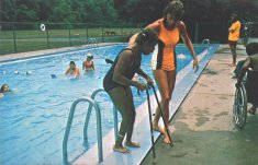 color photograph of two women by pool disability history america