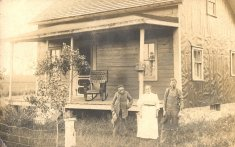 family outside house sepia photograph disability history america