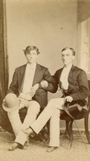 young men seated sepia photograph disability history america