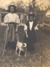 girls and dog sepia photograph disability history america
