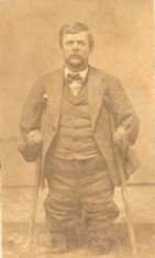 man with crutches sepia photograph disability history america