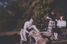man with golden retriever color photograph disability history america