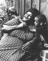mother sons playing black white photograph disability history america