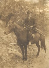 adult male amputee on horse sepia photograph disability america