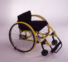 yellow wheelchair disability history america