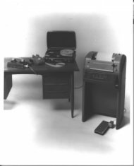 t t y on desk adjacent to braille converter black white photograph disability history america