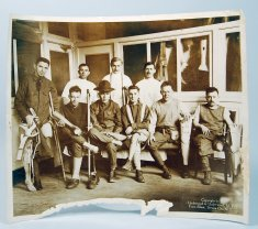 men standing and sitting sepia photograph disability history america