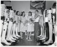 men women prosthetic limbs black white photograph disability history america