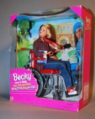 A Wheelchair Becky doll in original packaging.