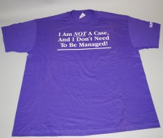 "A lavender T-shirt with the phrase ""I am not a case, and I don't need to be managed!"" in white letters."