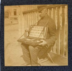 sepia photograph man begging disability history america
